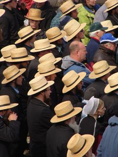 Amish straw hats at farm auction