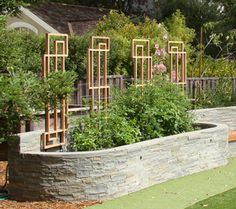 Like the modern trellis-possible diy for backyard :)