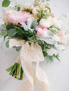 spring wedding bouquet, photo by When He Found Her http://ruffledblog.com/brooklands-farm-wedding #ranunculus #peach #weddingbouquet