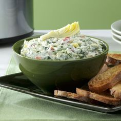 Cheese-Trio Artichoke & Spinach Dip Recipe from Taste of Home -- shared by Diane Speare of Kissimmee, Florida