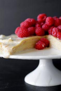 crepe cake with white chocolate ganache and raspberries