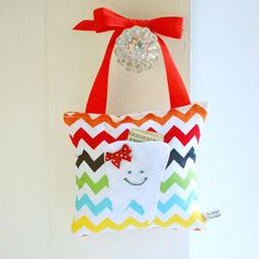 Girl's Tooth Fairy Pillow Tooth Fairy Gift for Kids in Rainbow Chevron Print. $18.00, via Etsy.