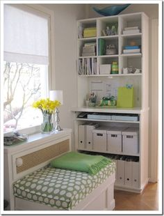 Craft room corner.  Love the crisp white with a splash of color, and the way everything is neatly in one corner.  Love the window seat!