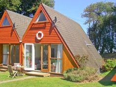 This contemporary, semi-detached Scandinavian-style lodge, with its quirky triangular design, sits in the delightful woodland setting of Kingsdown Park in Kent.