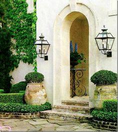 Pam Pierce: antique jardinieres, boxwoods and lanterns