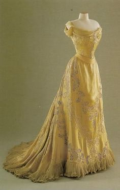Lady Curzon's Oak leaf dress by House of Worth, 1903,  The silk satin dress features over 400 oak leaves, outlined in satin cord and chenille thread. The darker leaves on the skirt were created by actually cutting out oak leaf shapes, and backing the holes with silk net. Copyright of the Fashion Museum in Bath and the NE Somerset Council.