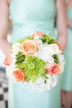 peach and green bouquet // photo by Courtney Dox Photography, florals by  WildFLowers, Inc., via http://theeverylastdetail.com/south-carolina-peach-mint-wedding/