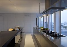 Free standing kitchen islands with granite worktops feature inside this renovated apartment.
