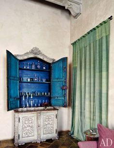 Katia and Marielle Labèque's Apartment and Studio in Rome/Axel Vervoordt.  Antique italian cabinet houses bar.