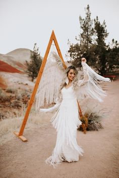 A fringe dress calls for twirling at the ceremony arch | Image by Alex Lasota Photography  | Pin discovered by Kelly's Closet bridal boutique in Atlanta, Georgia