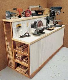 Work Bench with board storage.  Get my hubby organized!!!!!