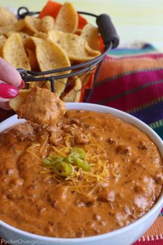 The BEST Chili Cheese Dip - This long time family favorite recipe has only 5 ingredients and is heated in the microwave for 5 minutes. This dip is gobbled up every time I make it! Be sure to save by pinning to your Recipe Board!