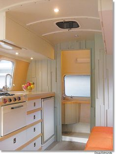 Beautiful Colors (although I'd go more aqua than mint). Restoring vintage trailer is pet project for husband-wife design team