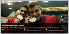 208a: A positive celebratory image of Mexican synchronised diver silver medal winners.  The focus is fully on their faces and their medals, giving emphasis to their achievement rather than physical. They are biting their medals as if they have 'cracked' the game.