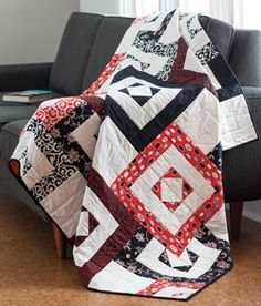 Interlock from Easy Quilts Fall 2013 is a throw size quilt pattern featuring interlocking squares that create a 3-dimensional illusion. Quilt by Wendy Sheppard.