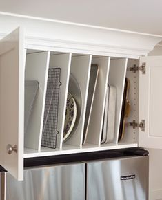 What do you with that awkward space above your fridge? Turn it into a storage unit for  platters, pans, cutting boards, cookie sheets, and more! Love it!