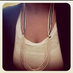 DIY: Attach a ribbon to a pearl necklace or any necklace.