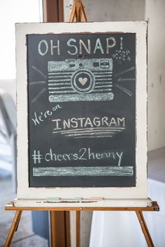 Create an instagram hashtag for your guests to use when posting pics from your wedding!  And a cute chalkboard sign to get the word out... Genius! © Great Heights Photography