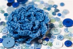 Great crochet flower, and I love her photography.  Rosette - Crochet Me by LadyVintage95
