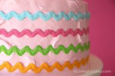 Easy cake decoration - add curvy ribbon to the outside! And BONUS: When you take the ribbon off, it leaves ruffles in your icing!