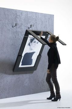 Flip up table turns into a picture frame.  This and many more space saving ideas.
