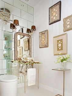 Wow! Visually expand a small bathroom with mirrors and reflective surfaces. This bathroom packs a dramatic punch with a wall tiled in mirrors, which also helps to add depth to the small space. A metallic vessel sink and shimmering hardware throughout the bathroom add to the glamorous effect of the mirrored wall. antique mirrors, bathroom idea, wall tiles, small bathrooms, mirror tile, subway tiles, mirrored walls, bathroom walls, powder rooms