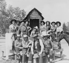 Group of men and women dressed in western wear for what may be the Canoga Park Cavalcade, circa 1940s. San Fernando Valley History Digital Library.