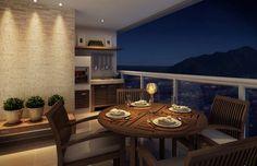 À noite, com a iluminação adequada, a varanda pode revelar um clima romântico. A vela sobre a mesa e o efeito de luz na parede contribuem para esse cenário.