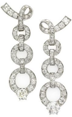 Chaumet Diamond Ear Pendants 1930s. Chaumet, A Pair of Diamond Ear Pendants, each designed as a series of graduated hoops set with circular-cut and cushion-shaped diamonds to ribbon surmounts, French assay and partial maker's marks, later clip fittings, later case by J. Chaumet, circa 1930s.