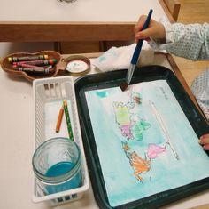 A big hit in the Geography area of my classroom-- painting and labeling the continents and oceans
