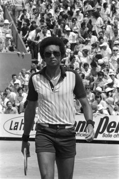 Arthur Ashe. The tennis great looked above defeat in his on-court gear, including shades, unbuttoned polo, short shorts, and belt. He's shown here in 1978 on the courts in Paris.