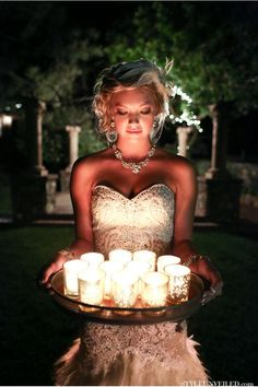 Love the glow from the candles onto this gorgeous bride! Great idea for photographing a bride and simple and inexpensive to create!
