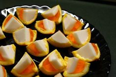 Candy Corn JELLO shots   Yield: About 80 shooters   1-750ml bottle Cointreau orange liqueur•10 large oranges•1 box orange Jell-O•1 can coconut milk•1 envelope Knox (unflavored) gelatin•1/4 cup sugar  Preparation: Cut the oranges in half and hollow them out.   For the orange layer: Boil one cup of water and stir in the orange jello.Once dissolved, remove from heat and add 1 cup of Cointreau.Pour the mixture into the orange peels, filling halfway.Refrigerate for 2-3 hours, until firm.  For the white layer: Add 1/2 cup of water, 1/2 cup coconut milk, Knox gelatin, and sugar to a saucepan.Over medium heat, stir until gelatin and sugar are dissolved.Remove from heat and add 1/2 cup Cointreau.Pour mixture on top of orange jello layer and refrigerate overnight.With a sharp knife, cut the orange halves in eighths. Serve.