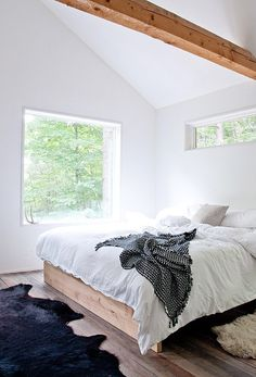 Bright and airy, modern and minimalist. Love the use of black and white, as well as wood tones
