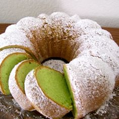 Pistachio Cake- 1 (18.25 ounce) package yellow cake mix, 1 (3.4 ounce) package instant pistachio pudding mix, 4 eggs, 1 1/2 cups water, 1/4 cup vegetable oil, 1/2 teaspoon almond extract, 7 drops green food coloring, & powdered sugar on top.