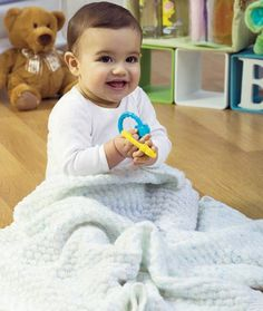 Learn how to knit a blanket with the Quilted Blankie. This free baby knitting pattern is easy to complete. Using the simple purl and knit stitches, it won't be long before you have yourself a knit baby blanket that will last a lifetime. The Quilted Blankie also makes quite the heartwarming baby shower gift for new mothers.