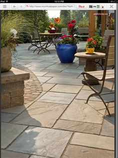 Backyard ideas stamped concrete contrast of smaller pavers on border and shape