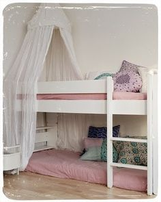 This is actually very close to what we plan to do with the girls' room.  We have a low loft already, and will put a bed under it on or nearly on the floor like this. Low loft bunk bed idea.