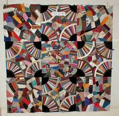 """Andover Historical Society crazy quilt made by Caroline Perkins Blunt Kimball and her mother, Jane Blunt, sometime in the late 1800's to early 1900's.  It is roughly 164 square centimeters and is made using a """"Japanese Fan"""" pattern of chunky circles and bright colors."""