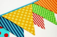 Handmade flag pennant banner for a carnival decoration perfect for home carnivals! If you are out of time or need a large outdoor carnival decoration - you can buy them for under 10 dollars for 100 feet of colorful flags!