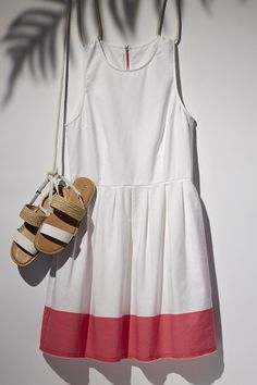 Dress up to hang out. Add hot pink to your summer whites for a beachy getaway. #summerloves