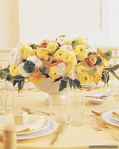 This sunny bunch of large and small blooms boasts creamy white, muted yellow, pale orange, and mossy green ranunculus