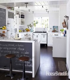 beach house kitchen. chalkboard island + vintage appliances | raised breakfast bar w/ waterfall edge countertop