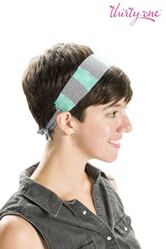 It's headband time! Cut up an empty 2-liter bottle to your desired width to create the perfect base for a fun statement accessory. Use a spray adhesive to glue on strips of your favorite Thirty-One fabric, punch holes at the base of the band, and complete the look with fun ribbon.