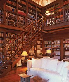 someday i will have wall(s) of books, and it will require stairs and/or a ladder. beauty and the beast style.
