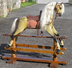 An Ayres horse from between 1900 to 1920 with most of his original paint and tack (including one pommel) surviving. The paint work on this horse has not been touched up in any way. One ear has been broken and glued on, the other had a damaged tip. There are a few cracks in the gesso and some small patches of worn surface but he is in fine condition for his age.