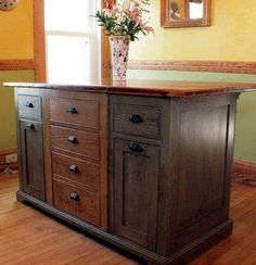 Rustic kitchen island with mixed wood colors and a wooden top