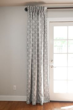 Gray curtains over French doors