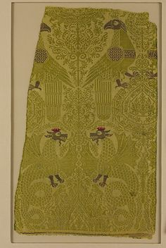 Textile Fragment with brocade with Bird, Dragon, and Palmette Motifs    Date:      13th century  Culture:      Italian  Medium:      Silk and metallic threads