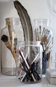 use jars to organize pens, pencils, brushes etc.